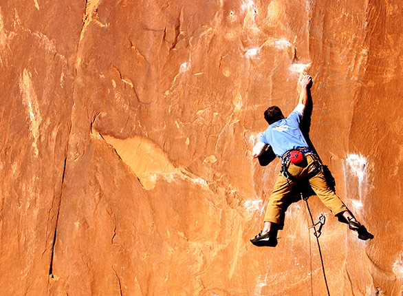 Guy Climbing Rock Wall